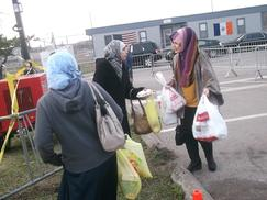 Safiyya distributing food to devastated victims in Staten Island