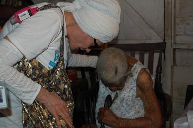 Safiyya embracing Mrs. Withley, the 105 year-old Jamaican woman.