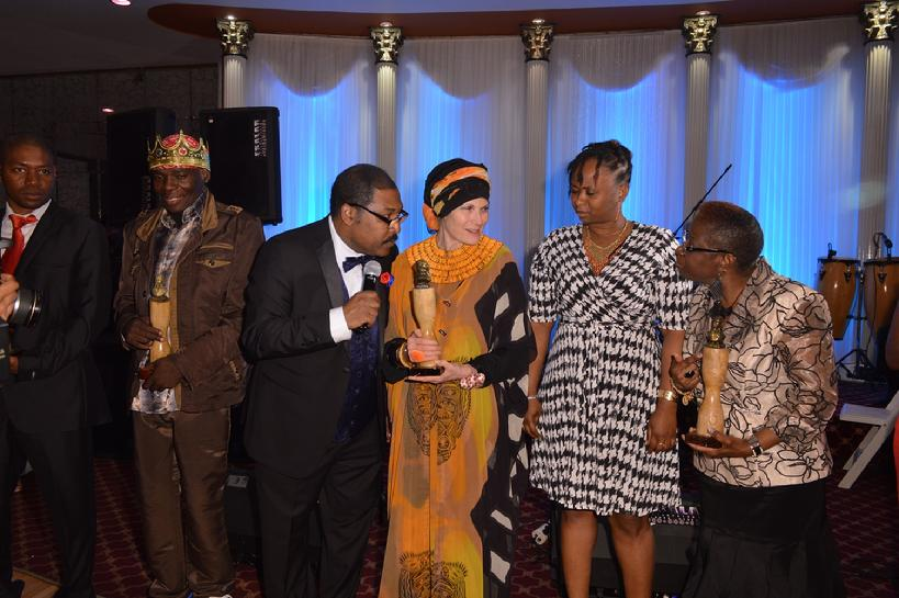 Safiyya Sarkin, the Excutive Director of Women Beyond Survival, accepting the Award from Smith Georges, the President of the Haitian Heritage Awards